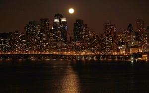 Super moon: A full moon rises over the skyline of Manhattan along the Hudson River