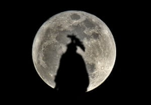 Super moon: The statue of freedom, on top of the US Capitol Hill