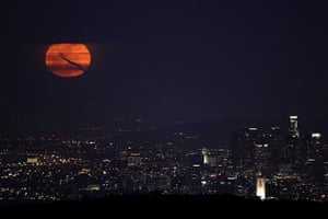 Super moon: The moon rises over downtown Los Angeles, California