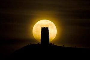 Super moon: Revellers stand beside St Michael's Tower on Glastonbury Tor