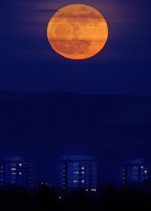 Super moon: The moon  rises from behind the hills of the Peak District