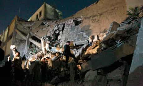 Libyan soldiers survey the damage to Moammar Gadhafi's Bab Al Azizia compound in Tripoli, Libya