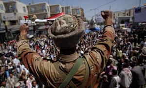 A Yemeni army defector joins protesters demanding the resignation of President Ali Abdullah Saleh