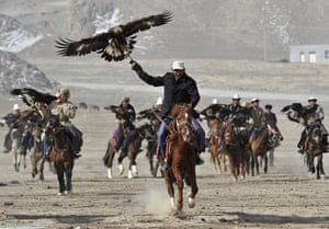 Spring festivals: Herdsmen from the Kyrgyz ethnic group hold falcons to celebrate Nowruz
