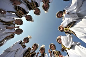 Spring festivals: Traditionally dressed Kyrgyz dance in the centre of Bishkek, Kyrgyzstan