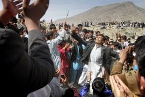 Spring festivals: Afghans dance outside the Sakhi Shrine on Nowruz, in Kabul, Afghanistan