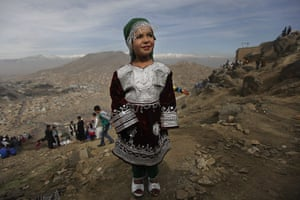 Spring festivals: An Afghan girl poses for a photograph