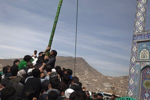 Spring festivals: Afghans try to kiss a religious flag to celebrate Nowruz in Kabul
