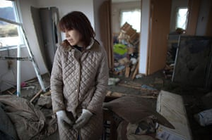 Japan salvage: Aki Kikawada stands in her apartment destroyed by the tsunami