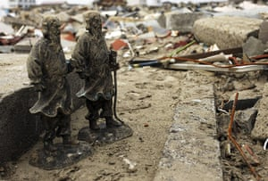 Japan salvage: The remains of a tombstone in a cemetery in Natori