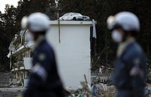 Japan salvage: A car on top of a destroyed building in Minamisanriku