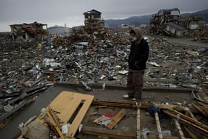 Japan salvage: A resident looks at his destroyed house in Rikuzentakata