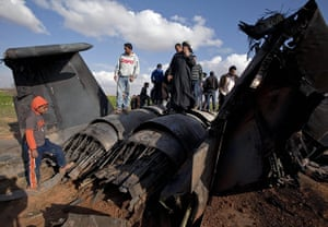 Sean Smith In Libya: 22 March: Libyans inspect the wreckage of a US F-15E Strike Eagle fighter