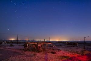 FTA: Jim Lo Scalzo  : An abandoned building sits in a salt pan near Bombay Beach