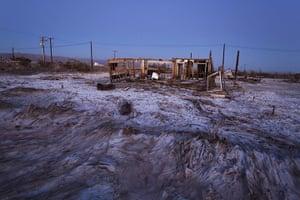 FTA: Jim Lo Scalzo  : An abandoned building sits in a salt pan near Bombay Beach, California