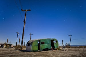 FTA: Jim Lo Scalzo  : An abandoned trailer is lit by a full moon