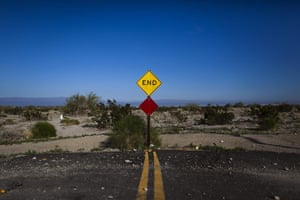 FTA: Jim Lo Scalzo  : A street sign marks the end of the road in Salton City