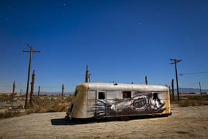 FTA: Jim Lo Scalzo: An abandoned trailer is lit by a full moon