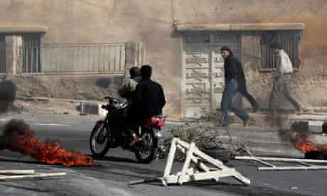 syrian police shoot protesters