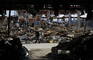 Japan aftermath: A resident is  walks through the rubble in Manami Sanriku