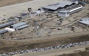 Japan aftermath: Destroyed vehicles at Sendai airport