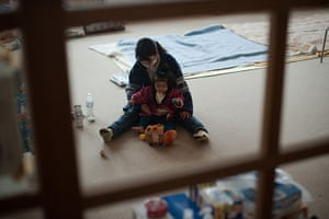 Japan aftermath: A woman plays with her daughter