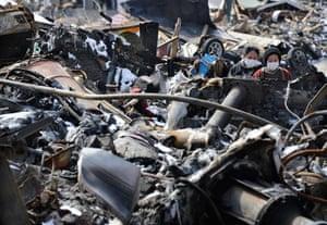Japan aftermath: People walk amid debris in Otsuchi, Iwate Prefecture