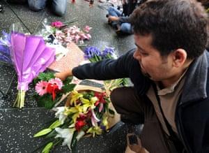 Elizabeth Taylor tribute: A fan places flowers on Elizabeth Taylor