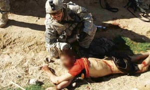 Jeremy Morlock, a member of the rogue US 'kill team', poses with an Afghan civilian corpse