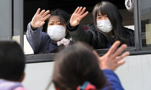 Japanese people evacuate from Minamisoma near the Fukushima nuclear plant