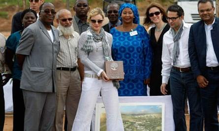Madonna laying the first stone of Raising Malawi Girls Academy