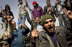 Ajdabiya seized by rebels: Libyan rebels celebrate after taking Ajdabiya