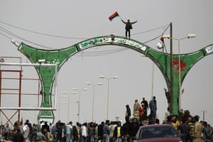 Ajdabiya seized by rebels: Rebels celebrate in the town of Ajdabiyah in eastern Libya