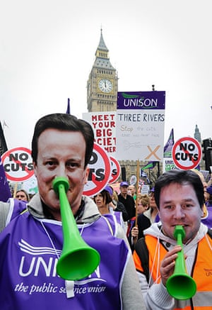 Protest against cuts: Two protestors wear David Cameron and Nick Clegg masks make