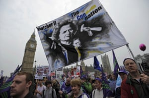 Protest against cuts: Demonstrators march past the Houses of Parliament