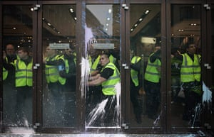 London Protest: Security secure the paint splattered doors as police and protesters clash