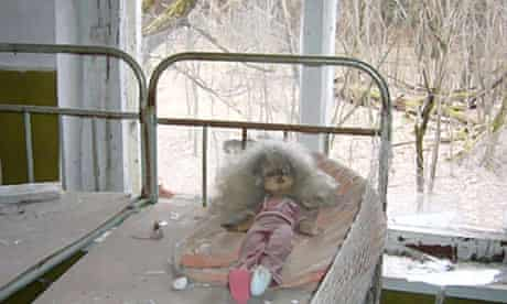 Chernobyl's legacy: a crackened and blackened doll in a classroom in the village of Kopachi.