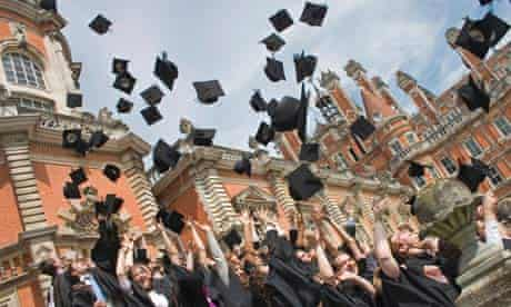 Graduating students throw mortarboards in the air