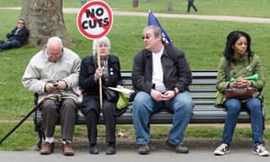 Demonstrators  rest in Hyde Park TUC march