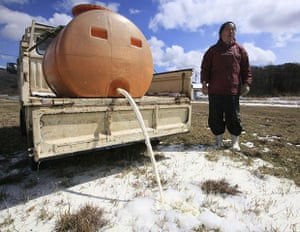 Japan earthquake: Fukushima nuclear accident  A dairy farmer empties out raw milk