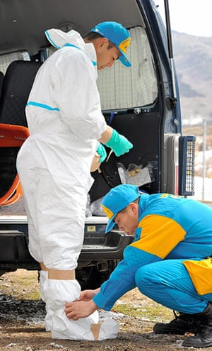 Japan earthquake: Fukushima nuclear accident : police with radiation protective suits