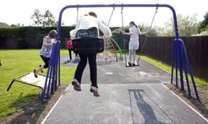Children playing happily on swings