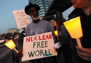 Japan nuclear crisis: Anti-nuclear demonstrators hold a candle