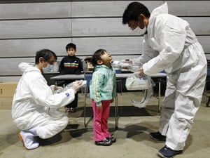 Japan nuclear crisis: tested for possible radiation exposure at an evacuation center in Koriayama