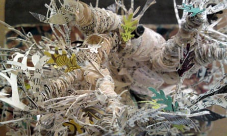 The tree's trunk and branches are made from hundreds of cut-out pages   pic: Michael MacLeod