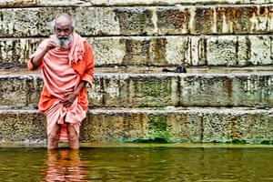 In pictures: rebirth: old man washing in the Ganges