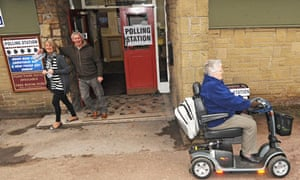 Members of the public leave a polling station in Barnsley.