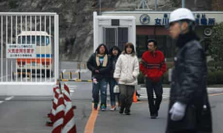 Tsunami survivors outside the Onagawa nuclear power station where they have been sheltering