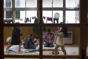 From the agencies: A family at a shelter in Rikuzentakata