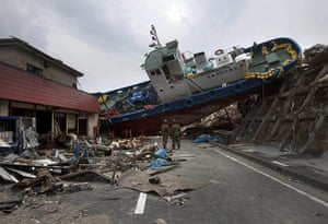 From the agencies: A boat blocking a road in Onagawa